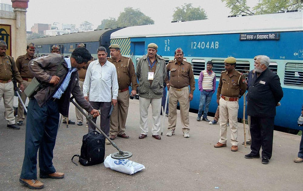 Bomb disposal squad members inspecting a bag after receiving a message of live bomb in a bag in the Vibhuti Express train at Allahabad station.