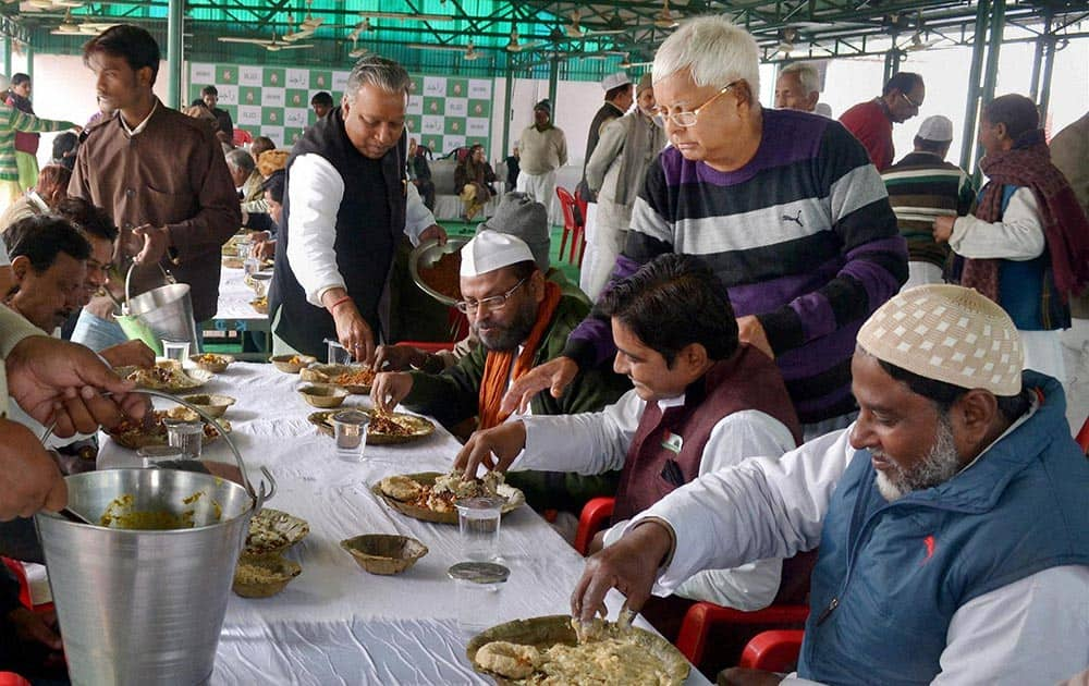 RJD Chief Lalu Prasad distributing Dahi -Chura to his party Muslim supporters during Makar Sankranti celebration in Patna.