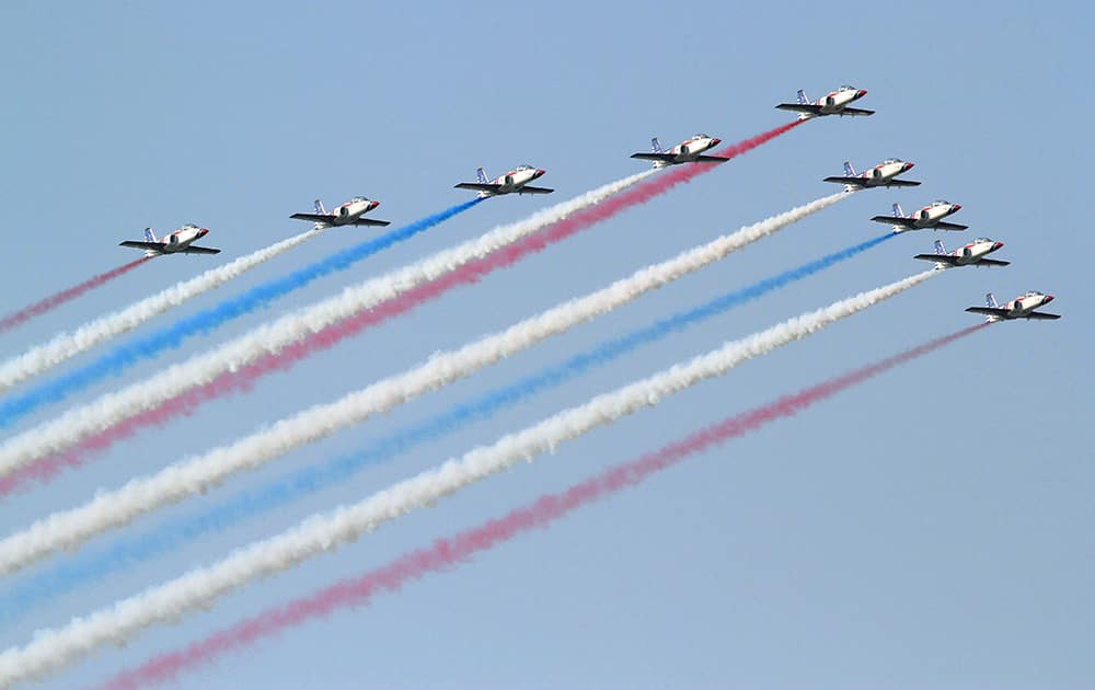 Taiwan`s AT-3 jet trainers fly in close formation over Tainan Air Force base in Taiwan. The air show marks the Air Force`s completion of the first batch of Taiwan`s upgraded indigenous defense fighter jets (IDF) and the installation of a new weapon system.