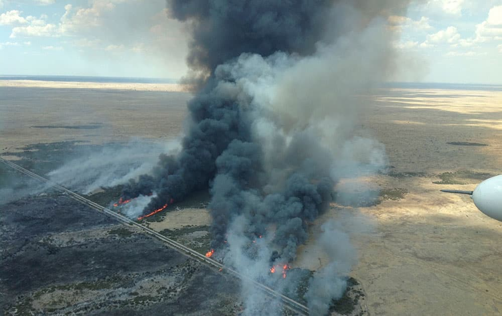 Aerial photo supplied by South Australian Country Fire Service, a large fire burns in Kiana in the State's Lower Eyre Peninsula, Australia.