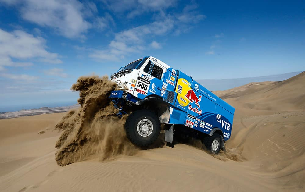 Driver Andrey Karginov and co-pilots Andrey Mokeev and Igor Devyatkin, all from Russia, ride their Kamaz truck up a dune during the tenth stage of the Dakar Rally between the cities of Iquique and Antofagasta, Chile.