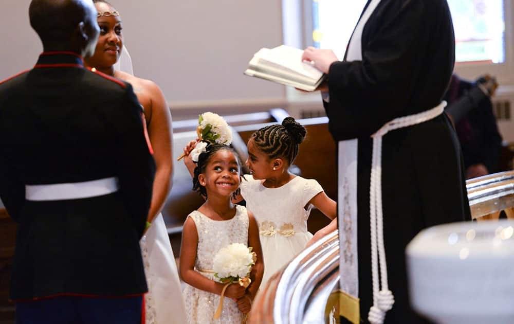 Peyton Wilcox, 4, smiles as her parents; Marine Corps Sgt. Stanly Wilcox and his wife Tashauna, renew their vows during a Weddings for Warriors ceremony, at Wesley Monumental United Methodist Church in Savannah, Ga. Eleven couples participated in the annual event.