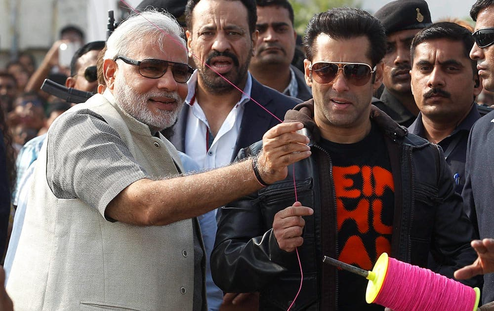 Gujarat Chief Minister and BJP`s PM candidate Narendra Modi with Bollywood actor Salman Khan during the Uttarayan Festival in Ahmedabad.