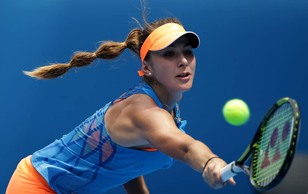 Belinda Bencic of Switzerland makes a backhand return to Li Na of China during their second round match at the Australian Open tennis championship in Melbourne.