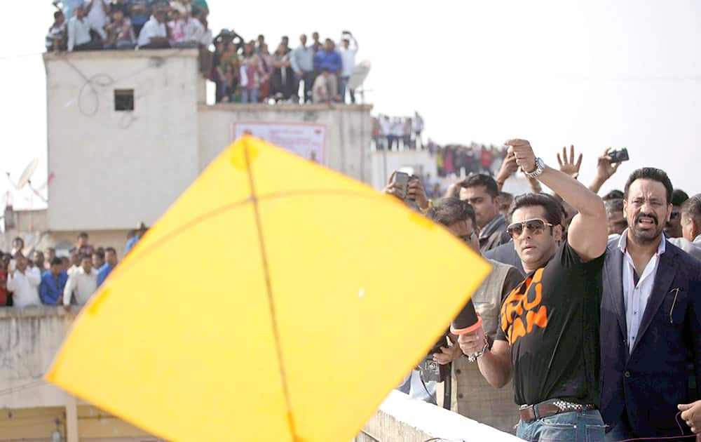 Bollywood actor Salman Khan flies a kite during the kite festival Uttarayan in Ahmedabad. Khan is in the city to promote his upcoming movie