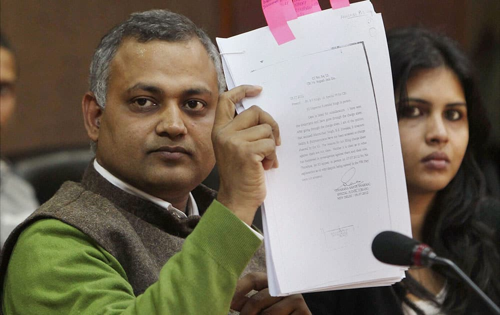 Delhi Law Minister Somnath Bharti shows a document during a press conference in New Delhi.