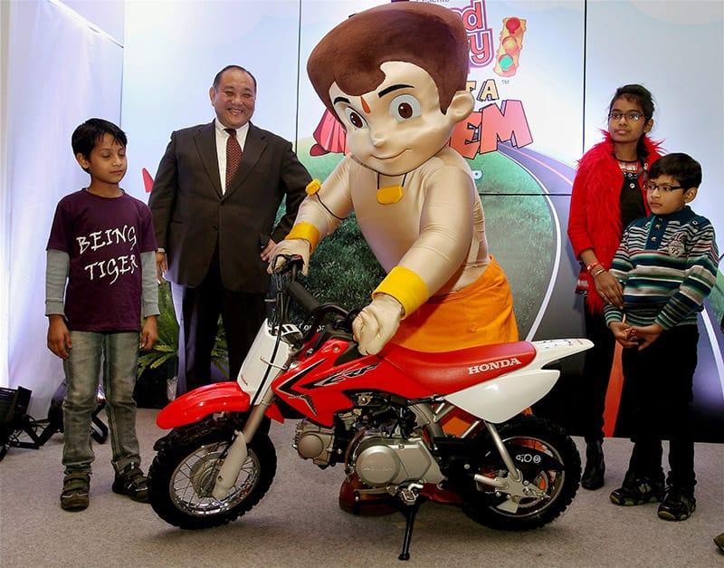President & CEO,Honda Motorcycle,Keita Muramatsu (2nd L) with Chhota Bheem launch kids Motorcycle in New Delhi.