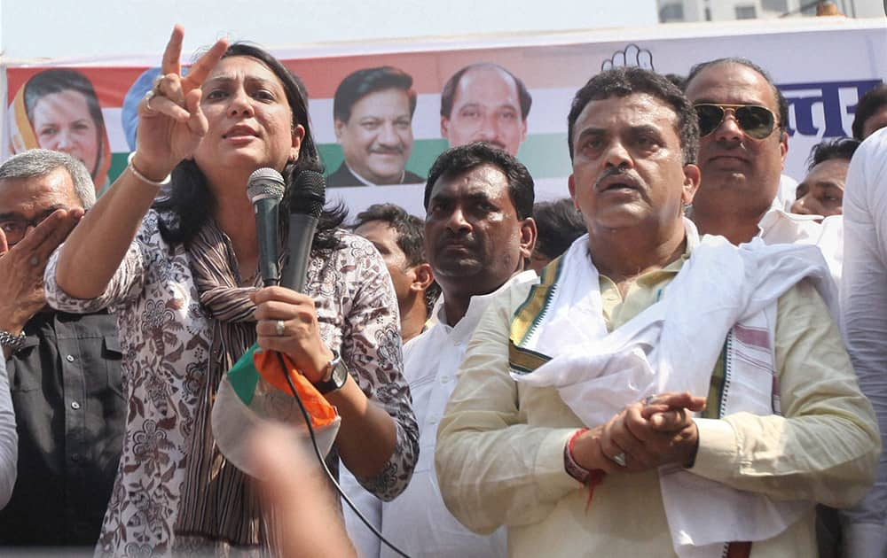 Congress MPs Priya Dutt and Sanjay Nirupam lead a protest outside the Reliance Energy office in Kandivali, Mumbai on Monday seeking reduction in power tariffs in the metropolis.