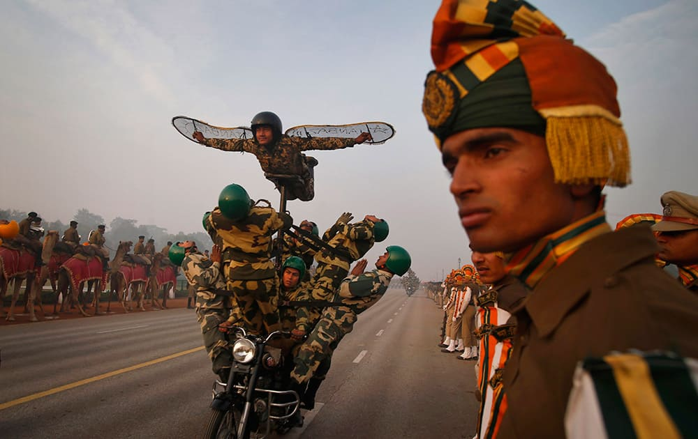 Indian soldiers perform on a moving motorcycle during Republic Day Parade rehearsals in New Delhi.