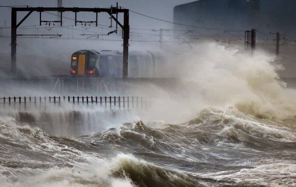 A train passes along the coast at Saltcoats in Scotland.