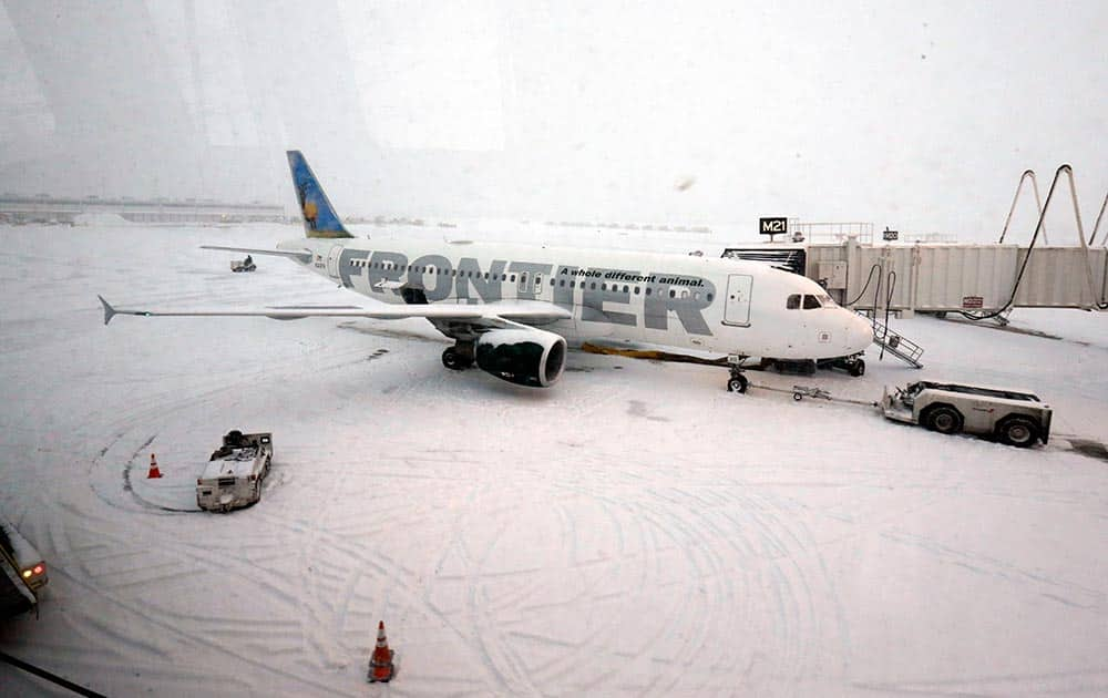 A Frontier airplane waits for passengers at O`Hare International Airport in Chicago.