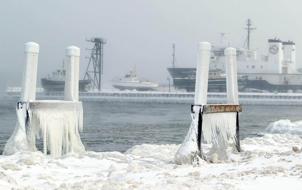 Ice forms on parts of a dock at West Bay Beach, a Holiday Inn Resort, on West Grand Traverse Bay near the Great Lakes Maritime Academy in Traverse City, Mich.