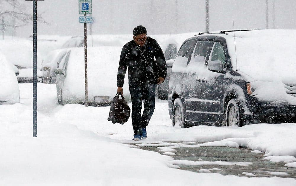 A traveler walks in the economic parking lot at O`Hare International Airport in Chicago.