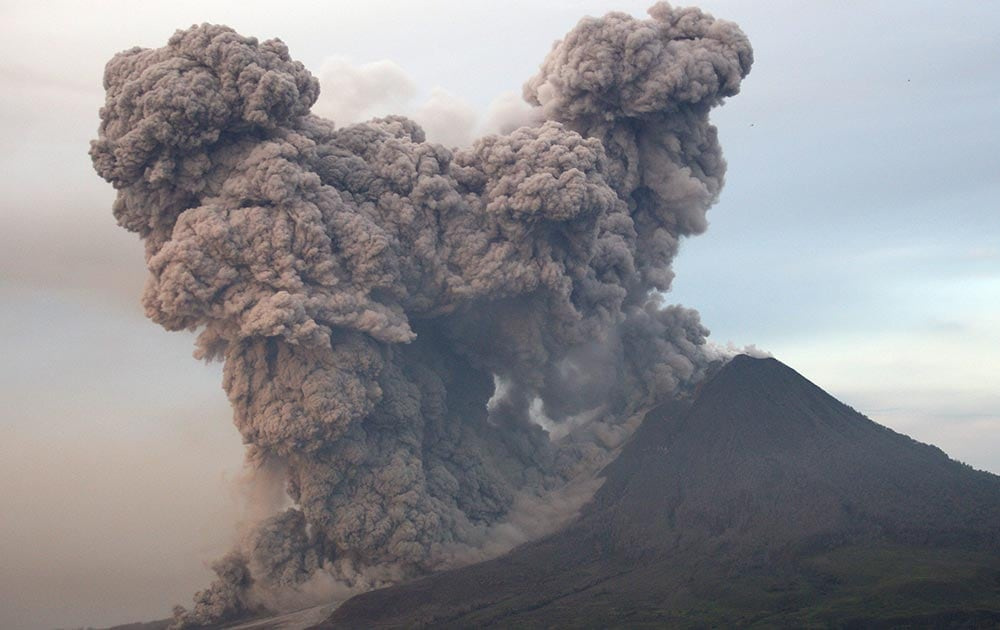 Mount Sinabung spews volcanic materials as seen from Gundaling, North Sumatra, Indonesia.