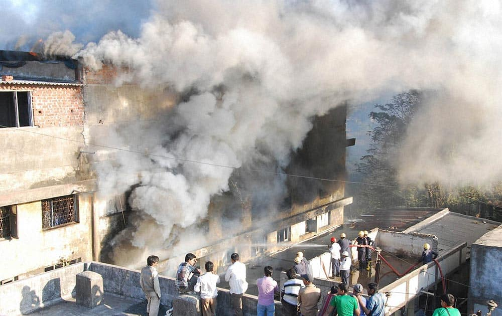 Smoke billowing out of a godown of seat covers after a fire broke out in Surat.