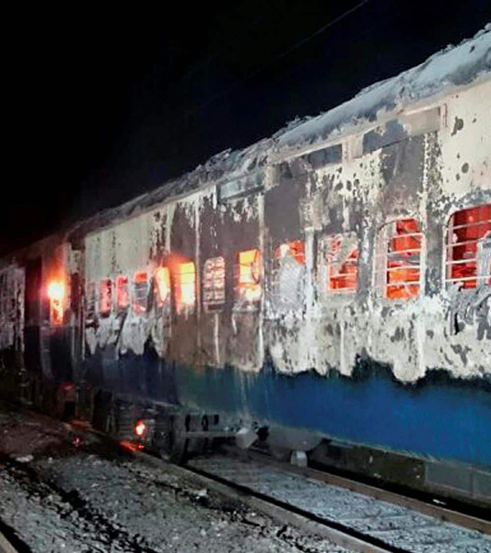Burnt coaches of the Mumbai-Dehradun Express which caught fire in the wee hours, near Dahanu in Thane district.