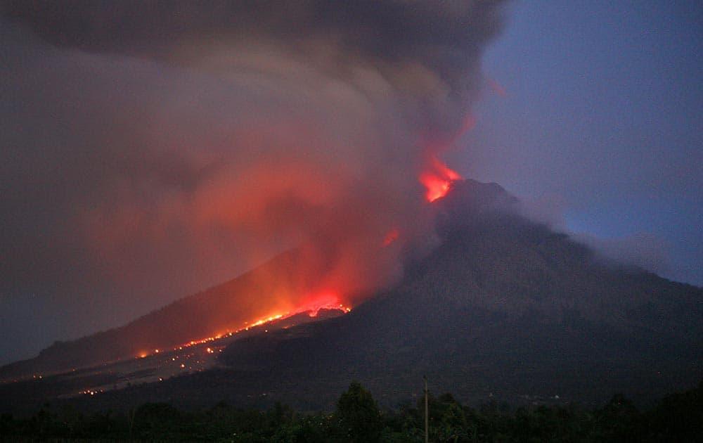 Mount Sinabung spews lava and volcanic ash as seen from Tiga Kicat, North Sumatra, Indonesia.