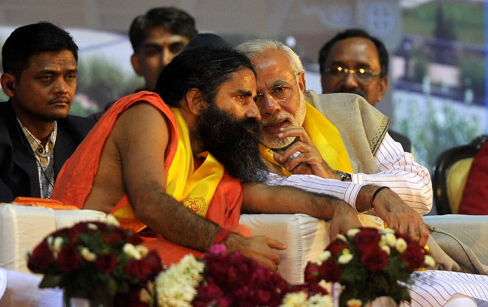Narendra Modi was chief guest at the foundation day ceremony of yoga guru Baba Ramdev`s Bharat Swabhiman Trust, at Delhi`s Talkatora Stadium. (Pic Courtesy: DNA)