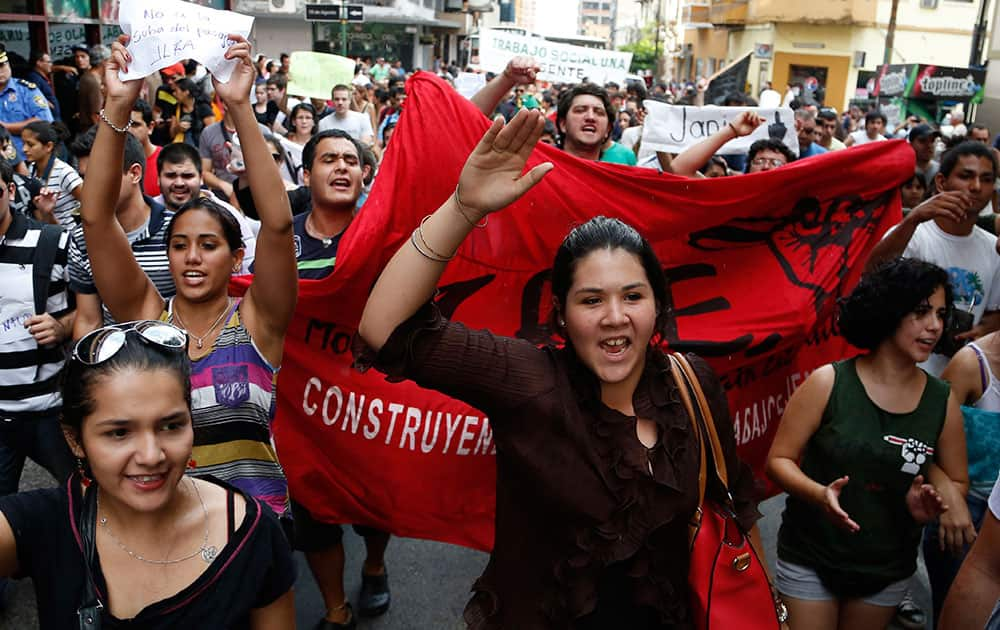 University students take to the streets in protest against a price hike in public transportation, in Asuncion, Paraguay.