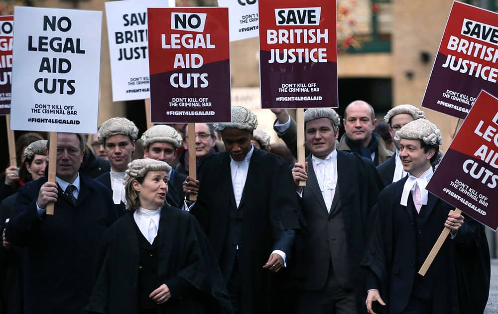 British lawyers protest outside Southwark Crown Court as they demonstrate against British government cuts to legal aid, in London.