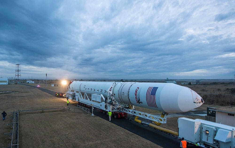 An Orbital Sciences Corporation Antares rocket is seen as it is rolled out to launch Pad-0A at NASA`s Wallops Flight Facility, Wallops Island, Va.