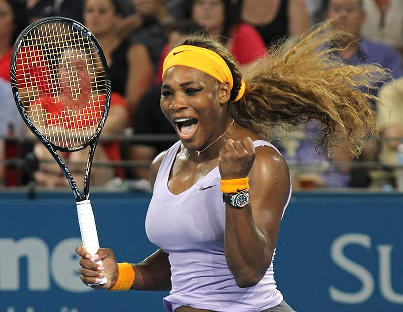 Serena Williams of the US celebrates after winning the women`s singles final match against Victoria Azarenka of Belarus 6-4, 7-5 during the Brisbane International tennis tournament in Brisbane, Australia.