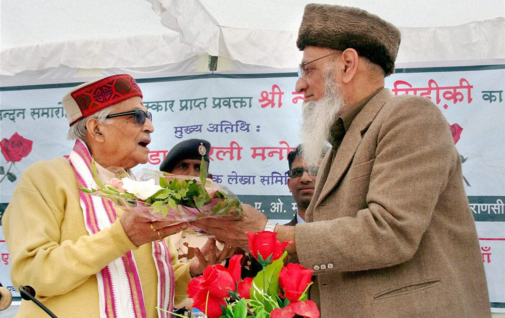 Senior BJP leader Murli Manohar Joshi receiving flower bouquets during a function of a school in Varanasi.