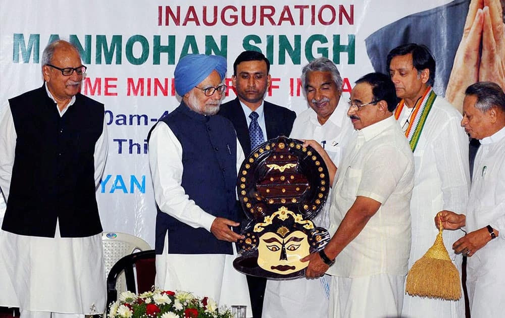 Prime Minister Manmohan Singh receiving a memento from Kerala Education Minister P K Abdu Rabb at a function in Thiruvananthapuram.