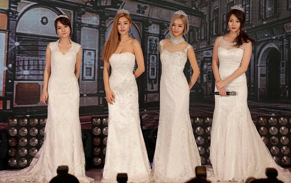 South Korean girl group Girl`s Day members pose for the media and fans during an event for their new album `Everyday III` in Seoul, South Korea.