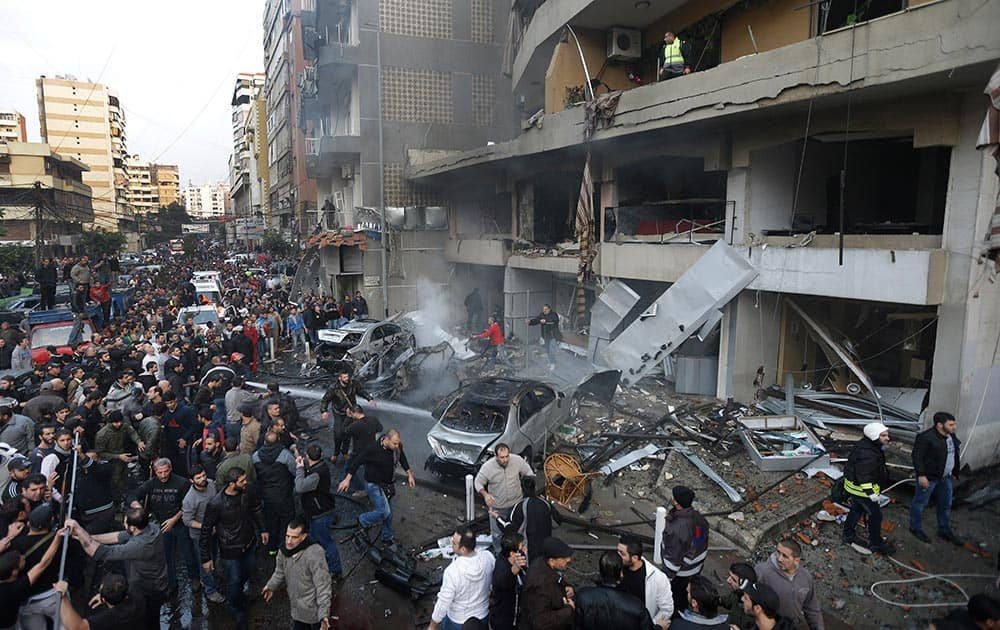 Lebanese citizens gather at the site of a car bomb explosion in a stronghold of the Shiite Hezbollah group at the southern suburb of Beirut, Lebanon.