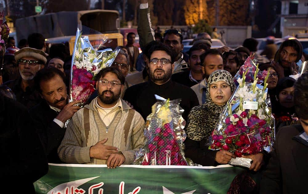 Supporters of Pakistan`s former president and military ruler Pervez Musharraf gather outside a military hospital where Musharraf is admitted in Rawalpindi, Pakistan.