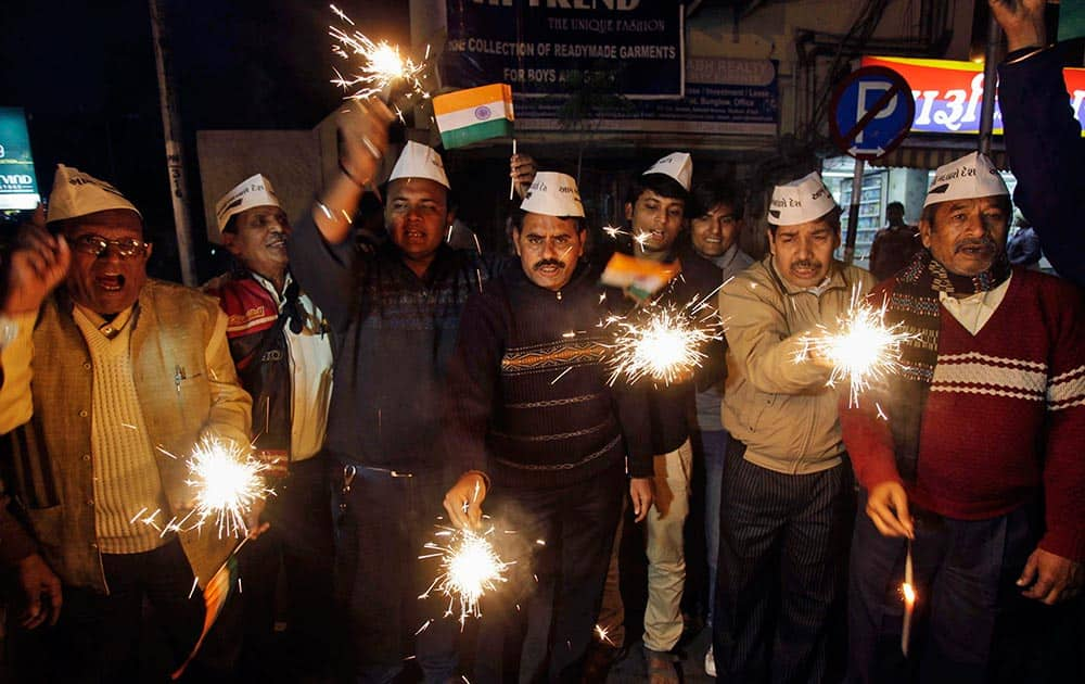 Indian supporters of the Aam Aadmi Party (AAP), or Common Man's Party, celebrate with firecrackers in Ahmedabad.
