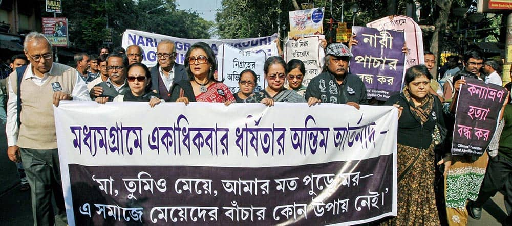 Eminent Film director Aparna Sen and Painter Samir Aich and Intellectuals take part in a protest rally against rape of a 16 years old girl, in Kolkata.