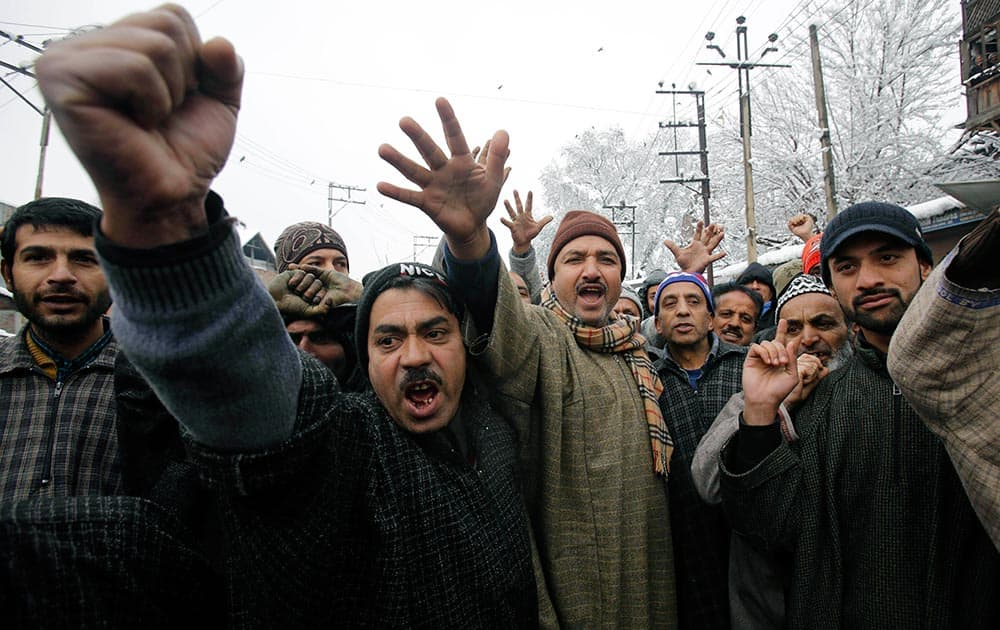 Kashmiri residents shout slogans against the state government and electric department as they block a road during a protest in Srinagar.