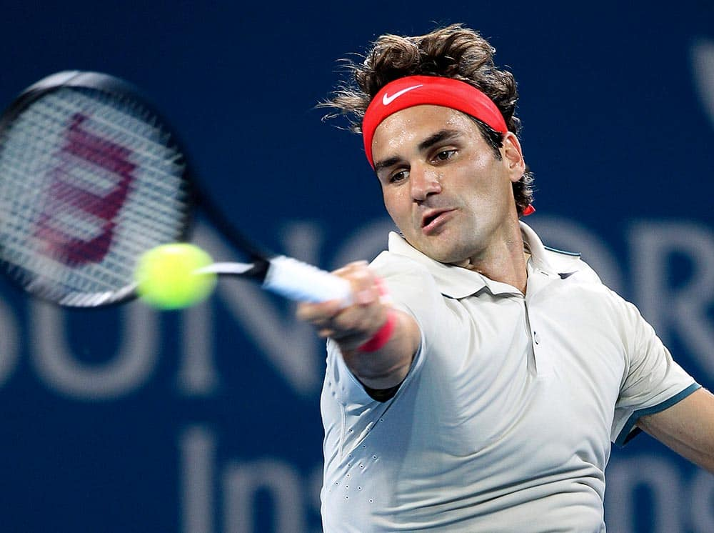 Roger Federer of Switzerland plays a shot in his match against Jarkko Nieminen from Finland during the Brisbane International tennis tournament in Brisbane, Australia.