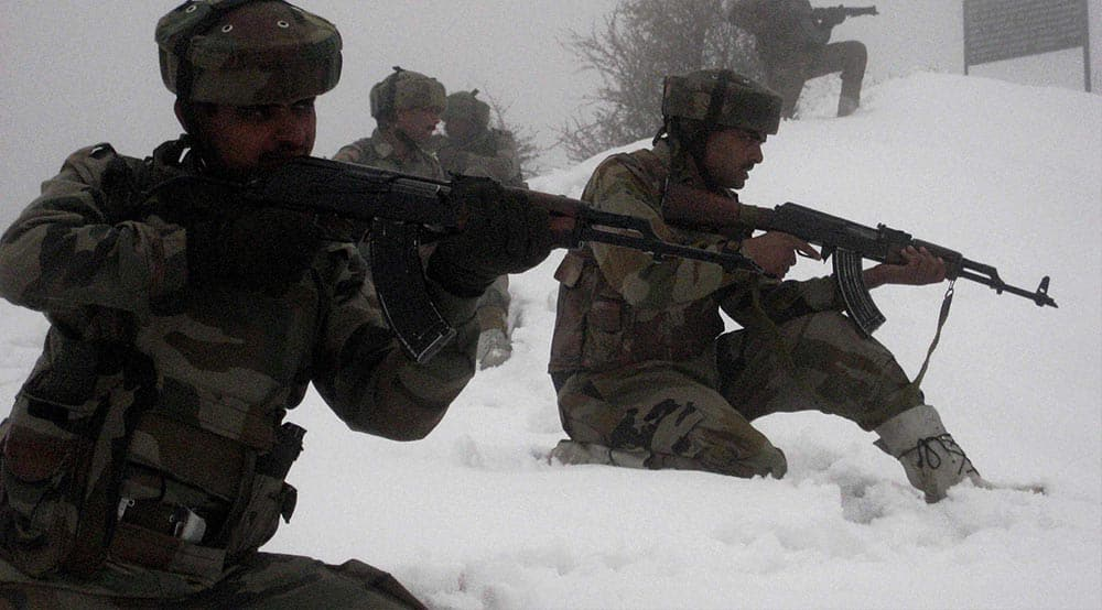 Army jawans keep vigil after the first major snowfall of the season in Poonch, Jammu & Kashmir.