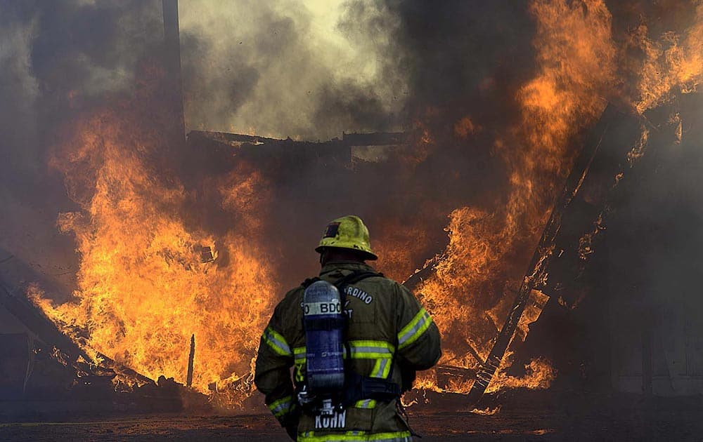 More than 20 fire units, from at least five agencies, fight a third-alarm fire, at an abandoned bowling alley, once known as the San-Hi Lanes, in San Bernardino, Calif.