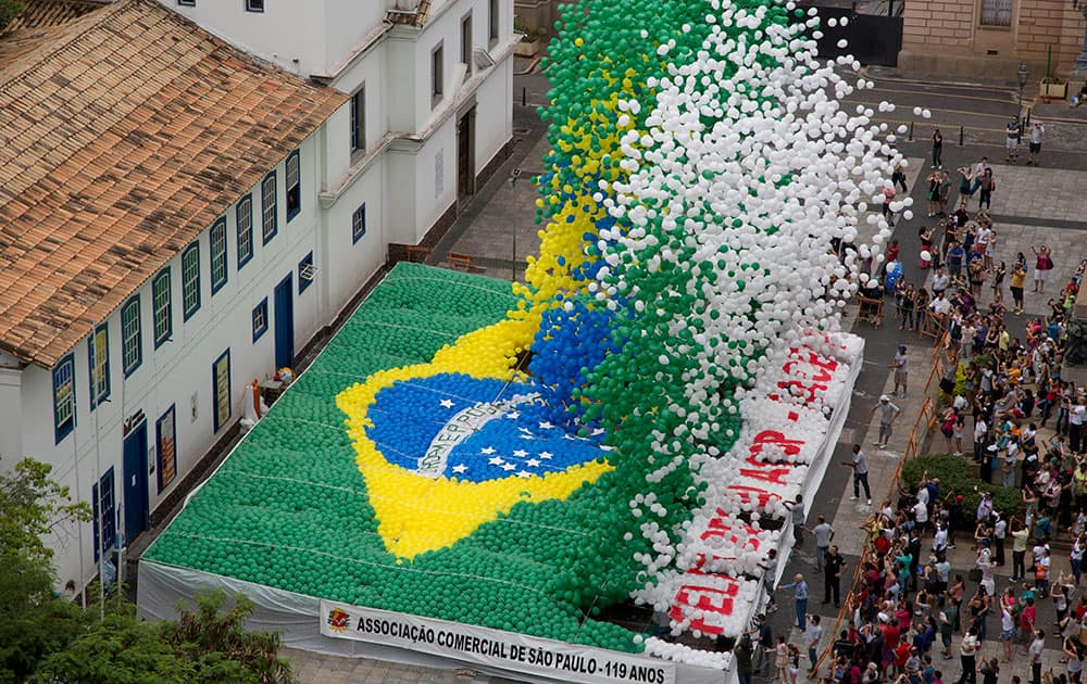 Members of Sao Paulo`s Commerce Association release thousands of balloons with the color of the Brazilian flag to celebrate the end of the year in downtown Sao Paulo, Brazil.