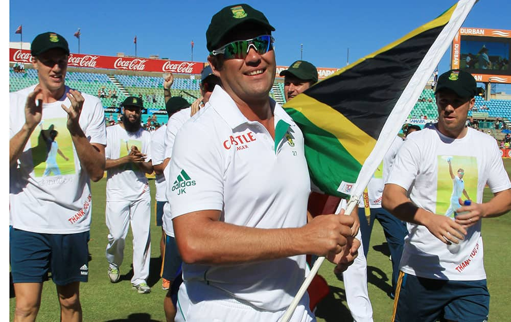 Jacques Kallis and teammates walk around the ground after he retired from Test cricket at end of the fifth and final day of their cricket test match against India at Kingsmead stadium, Durban, South Africa.