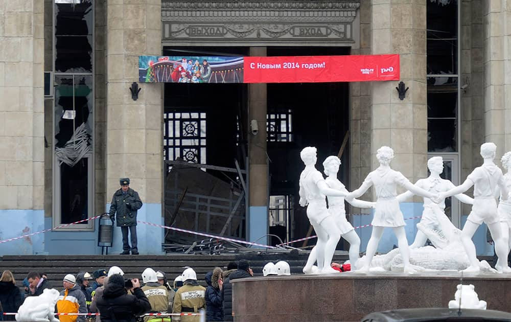 A police officer guards a main entrance to the Volgograd railway station hit by an explosion, in Volgograd, Russia.