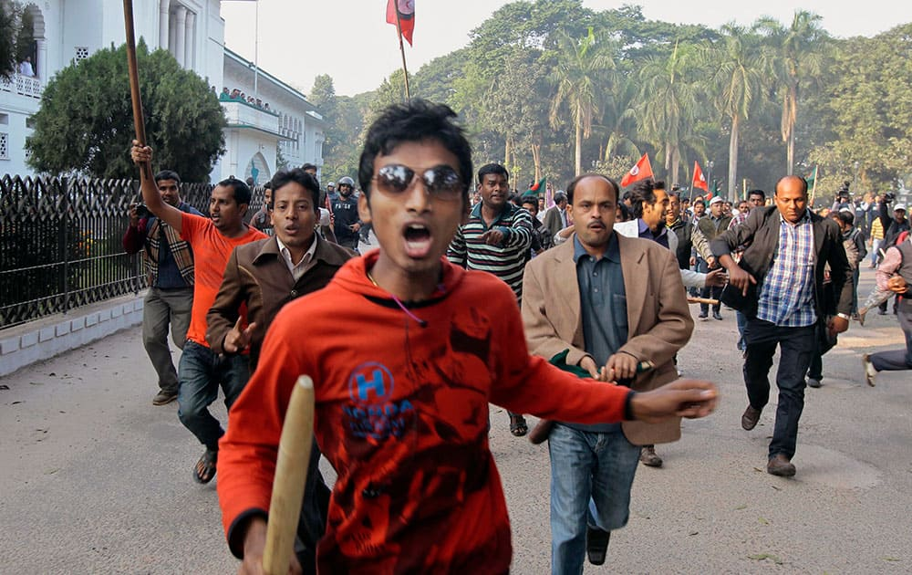 Supporter of the ruling Bangladesh Awami League chase supporters of the main opposition Bangladesh Nationalist Party (BNP) during a protest by opposition activists in Dhaka, Bangladesh.