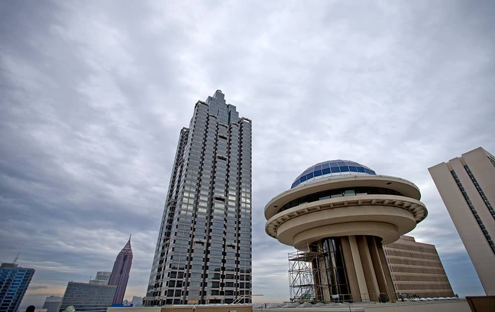 Polaris, the landmark blue dome that once dominated Atlanta`s skyline stands at right, in Atlanta. The spaceship-like structure has been vacant for years, and isn`t nearly as visible as it once was now that taller buildings have been constructed nearby. But managers of the downtown Hyatt hotel hope to harken back to the days when it opened in 1967.