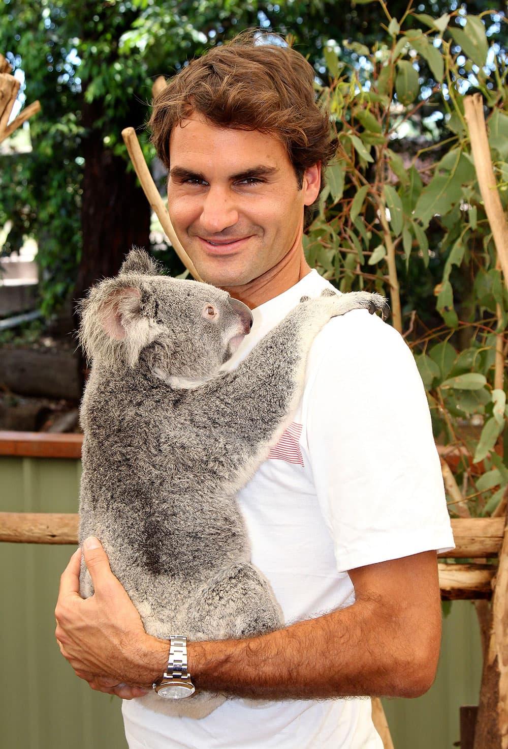 Roger Federer of Switzerland poses with a koala bear named Tinkerbell before the start of the Brisbane International tennis tournament in Brisbane, Australia.