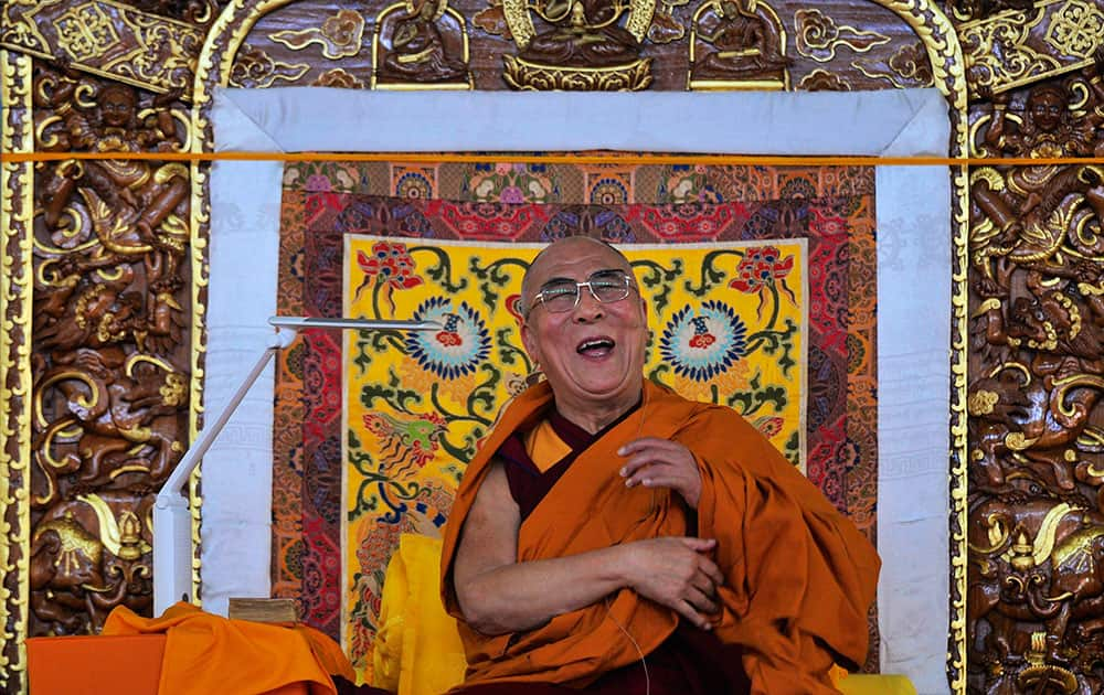 Tibetan spiritual leader the Dalai Lama laughs as he delivers the Jangchup Lamrim teachings in Bylakuppe, about 135 miles west of Bangalore, India.