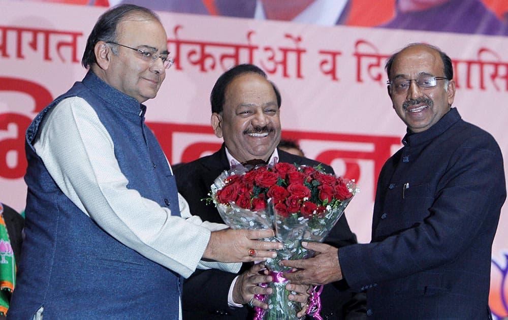 BJP leaders Arun Jaitley, Delhi BJP president Vijay Goel and Harshvardhan during a felicitation function for elected party MLAs in New Delhi.