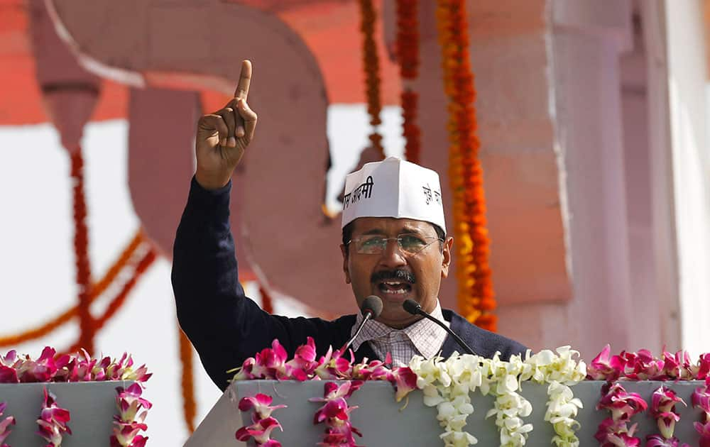 Aam Aadmi Party, or Common Man`s Party, leader Arvind Kejriwal speaks to the crowd after being sworn-in as chief minister of Delhi in New Delhi.