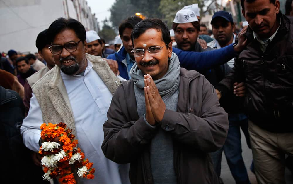 Aam Aadmi Party, or Common Man`s Party, leader Arvind Kejriwal greets supporters during a public meeting in New Delhi.