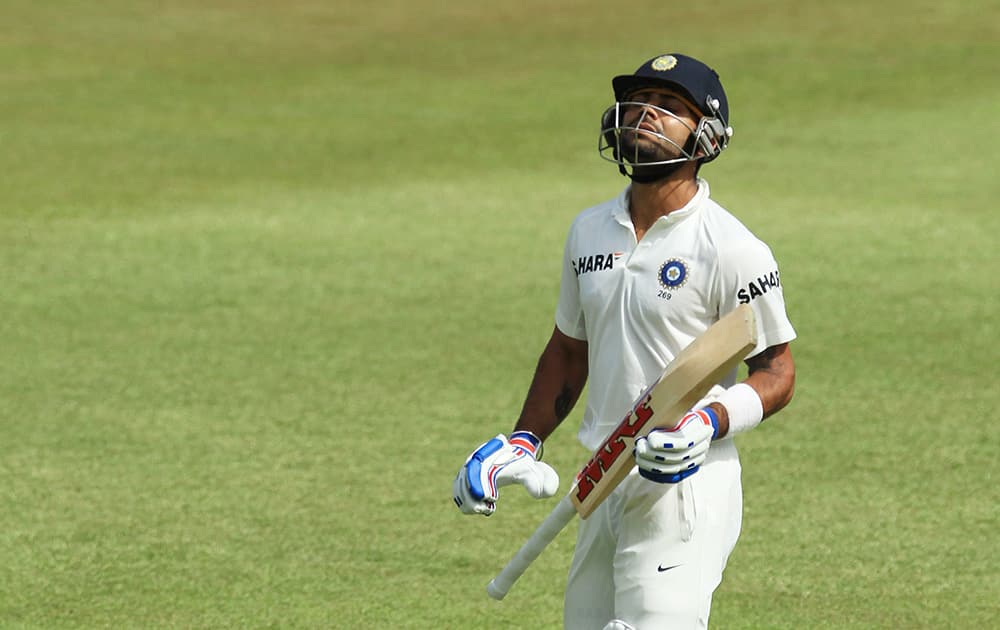 Virat Kohli leaves the field after being dismissed by South Africa`s bowler Morne Morkel, for 46 runs during the second day of their cricket test match at Kingsmead stadium, Durban, South Africa.