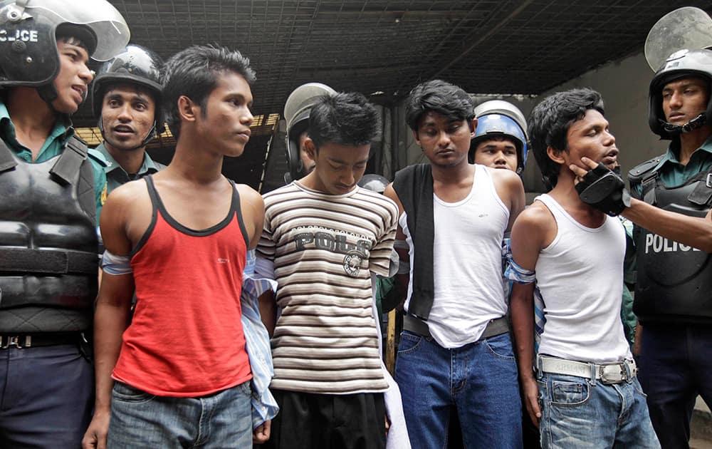 Bangladeshi policemen detain activists of the banned Islamic group Hizb-ut Tahrir on a street in Dhaka, Bangladesh.