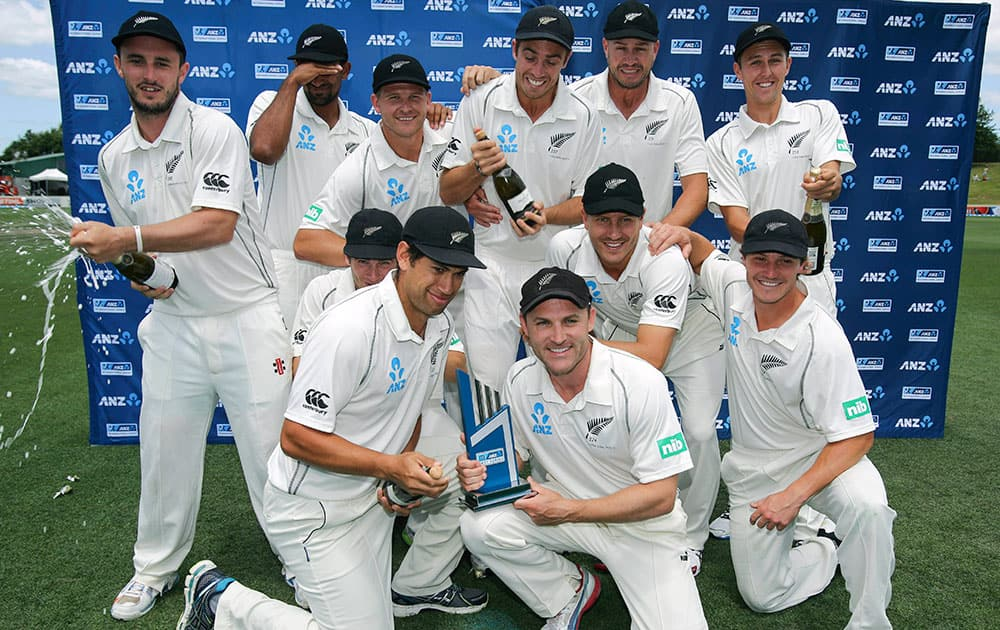 New Zealand celebrate their series win over the West Indies in the third cricket test, at Seddon Park, in Hamilton, New Zealand.